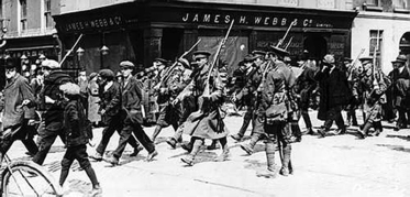 Rebel prisoners being marched out of Dublin by British Soldiers May 1916 The Easter Rebellion, was an armed uprising of Irish nationalists against the rule of Great Britain in Ireland. The uprising occurred on Easter Monday, April 24, 1916, and centred mainly in Dublin. The chief objectives were the attainment of political freedom and the establishment of an Irish republic. Centuries of discontent, marked by numerous rebellions, preceded the uprising. The new crisis began to develop in September 1914, following the outbreak of World War I, when the British government suspended the recently enacted Home Rule Bill, which guaranteed a measure of political autonomy to Ireland. Suspension of the bill stimulated the growth of the Citizen Army, an illegal force of Dublin citizens organised by the labour leader Jim Larkin (died 1948) and the socialist James Connolly (1870-1916); of the Irish Volunteers, a national defence body; and of the extremist Sinn FŽin. The uprising was planned by leaders of these organisations, among whom were the British consular agent Sir Roger David Casement, the educator Padhraic Pearse (1879-1916), and the poet Thomas MacDonagh (1878-1916). Hostilities began about noon on April 24, when about 2000 men led by Pearse seized control of the Dublin post office and other strategic points within the city. Shortly after these initial successes, the leaders of the rebellion proclaimed the Independence of Ireland and announced the establishment of a provisional government of the Irish Republic. Additional positions were occupied by the rebels during the night, and by the morning of April 25 they controlled a considerable part of Dublin. The counteroffensive by British forces began on Tuesday with the arrival of reinforcements. Martial law was proclaimed throughout Ireland. Bitter street fighting developed in Dublin, during which the strengthened British forces steadily dislodged the Irish from their positions. By the morning of April 29, the post offic